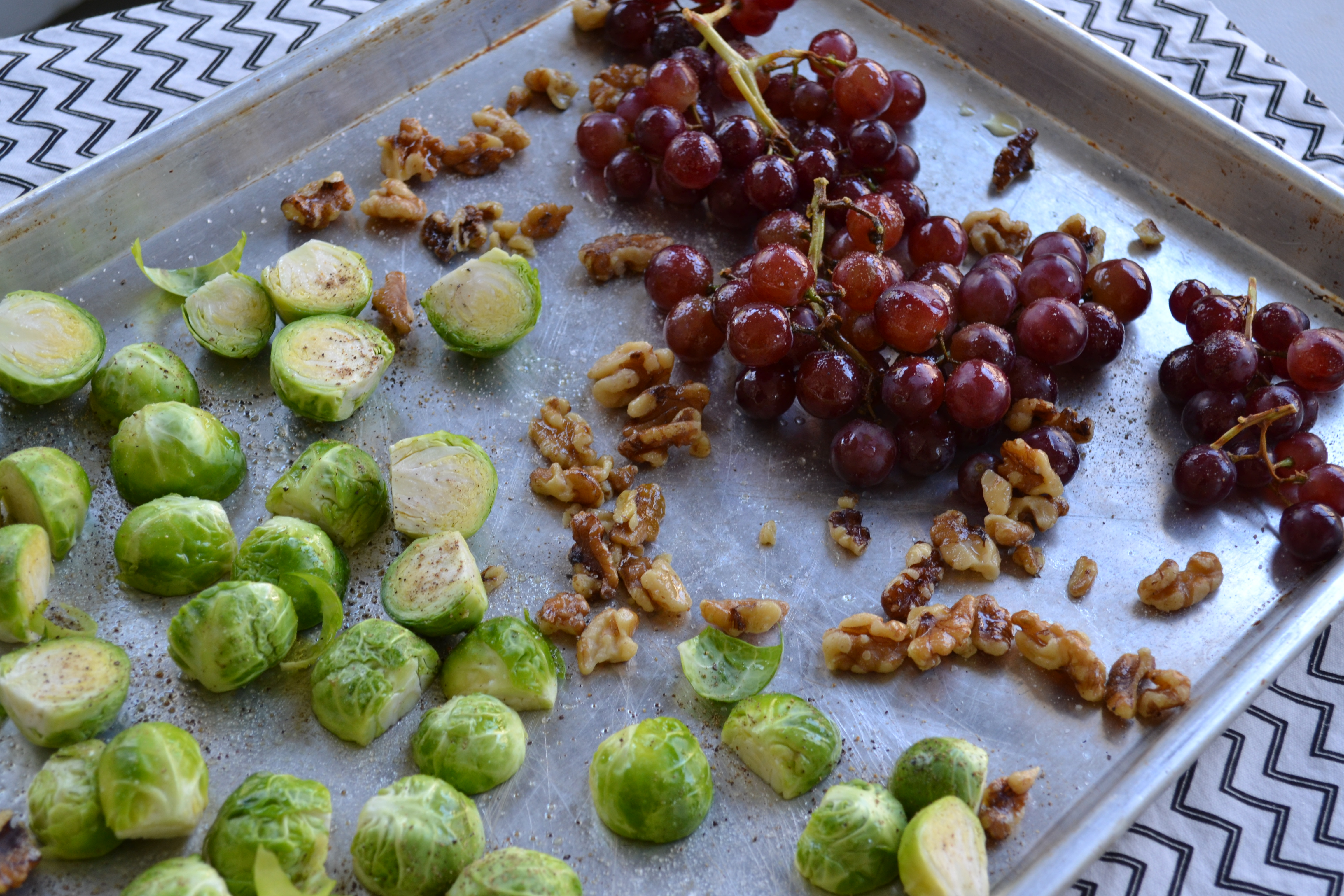 ROASTED BRUSSELS SPROUTS, GRAPES, AND WALNUTS WITH BALSAMIC DRIZZLE